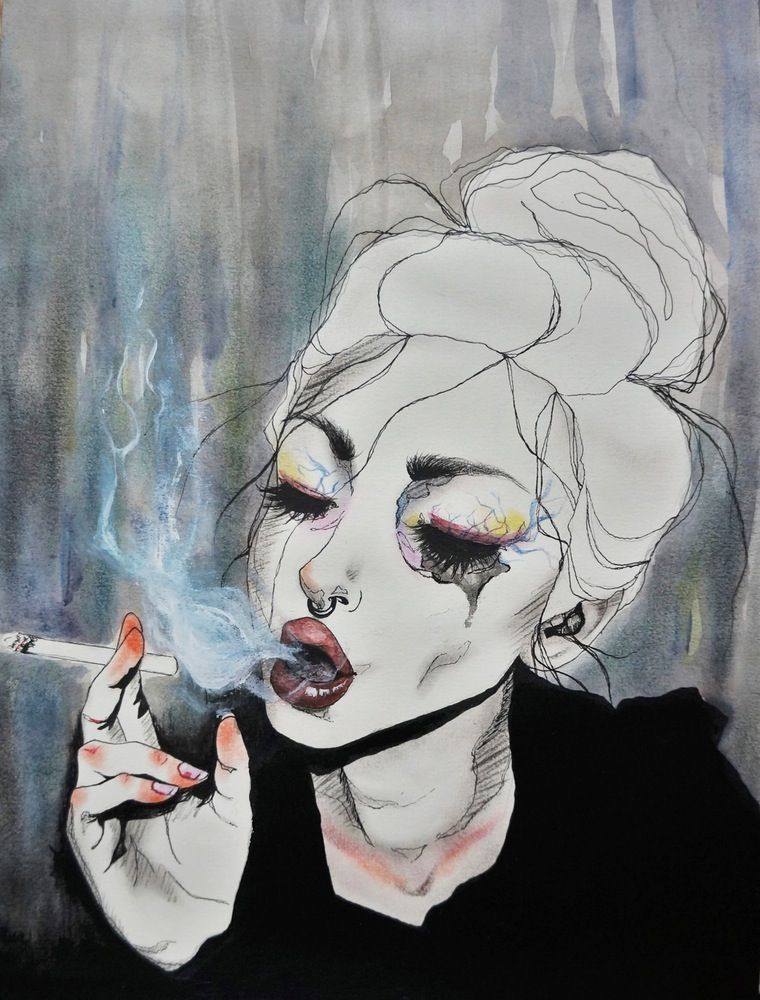 Mujer triste fumando