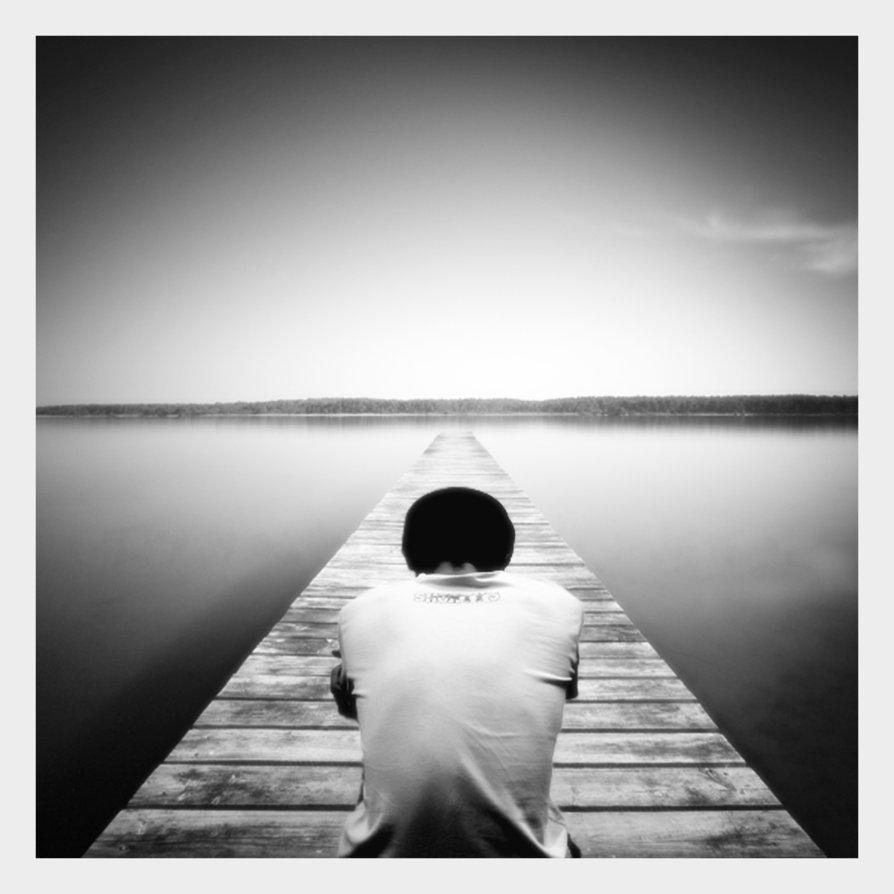 Sentado en un puente